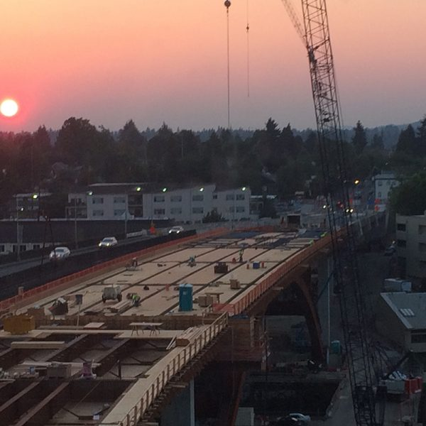 The sun rises over the curing Sellwood Bridge on October 20, 2015